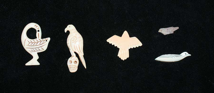 Two carved bone birds and several different sea shell birds. used in bone divination