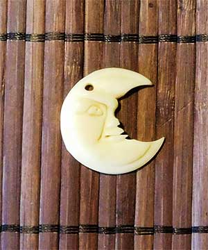 Carved bone crescent moon.