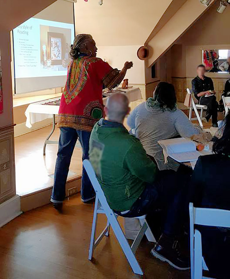 Me giving my PowerPoint presentation before the spirits decided that I needed to just sit down and show folks how I do it instead of all the show and tell and razzmatazz... photo by Candelo Kimbisa