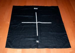 Black Cloth with a white cross drawn in the center