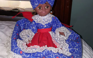 Candelo found this beautiful doll at one of the Denver Thrift Shops photo by Candelo Kimbisa