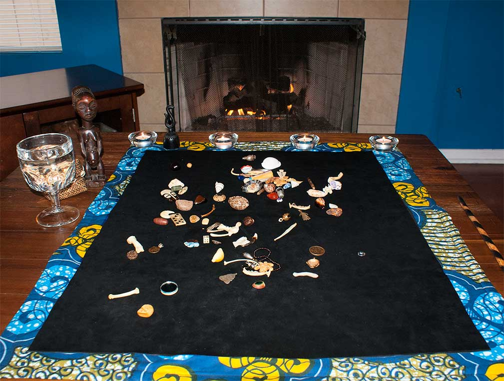 A bone divination set on a mat.
